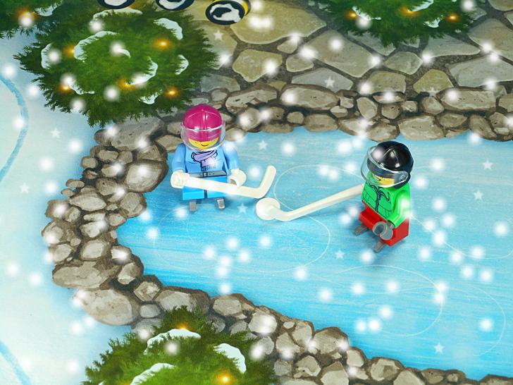 少女と少年のアイスホッケー
